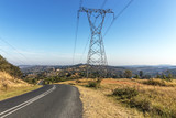 Overhead Pylon and Powerlines Next to Asphalt Road - 209027848