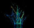 Splash of color ink on black background