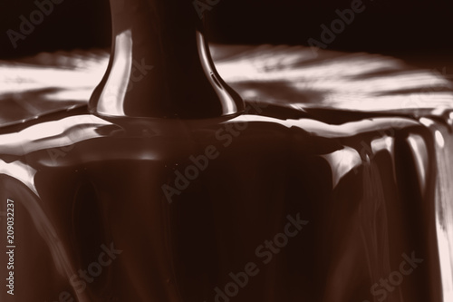 Fotobehang Chocolade Pouring liquid hot chocolate closeup. Cooking dessert.