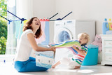 Family in laundry room with washing machine - 209047416
