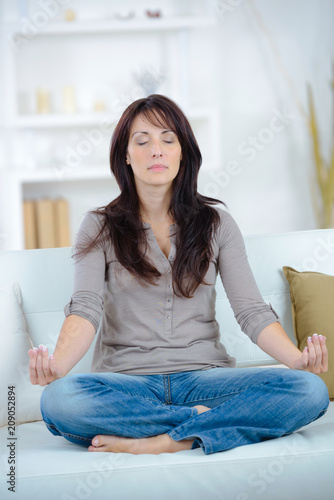 woman practicing yoga after waking up