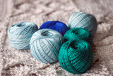Multicolored yarn balls on a knitted wrap