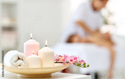 composition of spa candles and   towels © JenkoAtaman