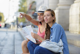 young beautiful woman travelers exploring the city - 209060050