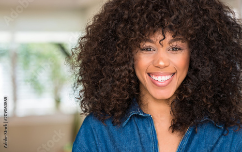 Leinwanddruck Bild African american woman with a happy face standing and smiling with a confident smile showing teeth