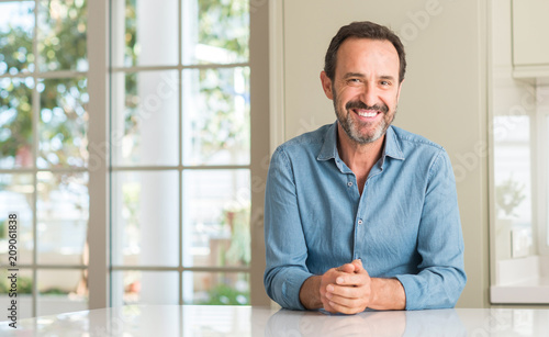 Leinwanddruck Bild Handsome middle age man with a happy face standing and smiling with a confident smile showing teeth