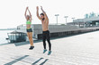 Leinwanddruck Bild - Fit fitness woman and man doing fitness exercises outdoors at city