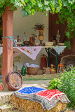 Traditional Hungarian objects exhibited on one home porch - 209086413