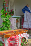 Traditional Hungarian objects exhibited on one home porch - 209086429