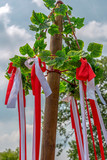 Tree decorated with leaf and colored ribbons - 209086473