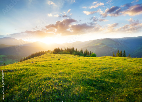Sunset in the mountain valley. Beautiful natural landscape in the summer time
