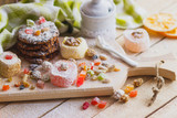 Eastern sweets with fruits, nuts and sugar powder - 209089484