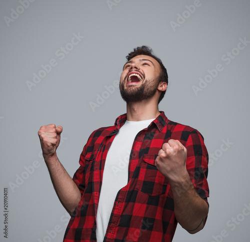 Super excited man celebrating win
