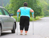 Disabled woman upgoing from a car. Transportation and travel for handicapped people. - 209104667