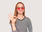 Trendy girl showing OK gesture on white - 209105271