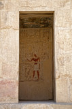 Wall murals and hieroglyphs in the temple of Queen Hatshepsut in Egypt - 209108016
