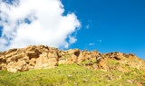 Rock formations from sandstone in the steppe relief - 209109453