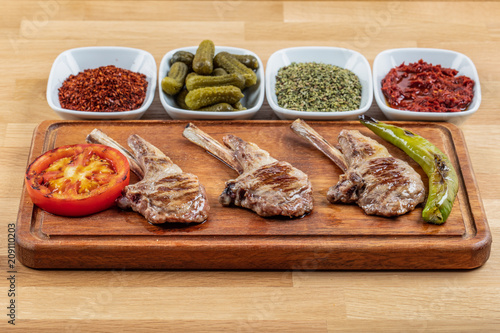 Grilled Lamb Chops.grilled tomato, grilled pepper tomato, grilled pepper of Lamb and Peppercorns.