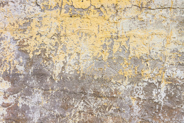 Weathered concrete wall with paint peeled