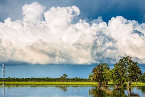 Foto Murales Cumulonimbus Clouds Over Flood Field