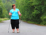 Overweight woman walking on forest trail. Slimming and active lifestyle theme.  - 209130073