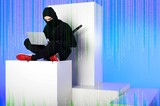 ninja in black clothing using laptop while sitting on white block with code on blue - 209138284
