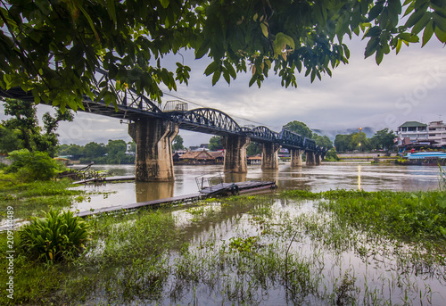 Bridge over the River Kwai with atmosphere after rain /Thailand - 209144489