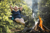 Woman tourist resting in the camp near the fire. - 209157844