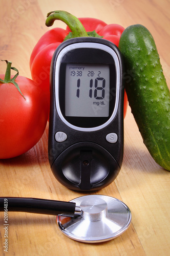 Vegetables, glucometer for checking sugar level and stethoscope, concept of healthy lifestyle, nutrition and diabetes