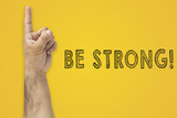 Be Strong, Success concept. Hand gesture finger pointing finger next to the inscription: Be Strong - 209167477