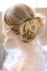 Back view of bridal hairstyle. Concept of wedding day and fiancee. © sisterspro