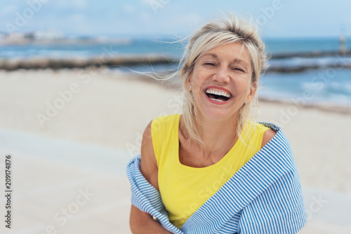 Leinwandbild Motiv Laughing vivacious woman with a sense of humour