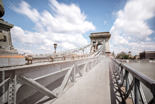View on the pedestrian way with motion blurred people on the Chain bridge in Budapest city, Hungary