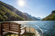 Dam in South Africa seen from deck of pleasure boat with bench in foreground. The Blyde dam.
