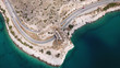 Aerial drone bird's eye view photo of Tunnel in Athens riviera seaside road known as hole of Karamanlis, Attica, Greece - 209190686