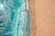 Leinwanddruck Bild - Coastline Beach Ocean waves with foam on the sand. Top view from drone.