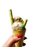 Hand holding Green tea and fruit ice cream