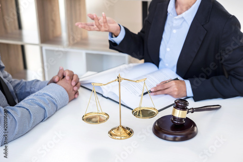 Having meeting with team at law firm, Consultation between a female lawyer and businesswoman customer, tax and contract the company of real estate concept