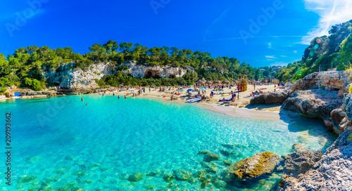 Leinwanddruck Bild Panoramic view of Cala Llombards beach with turquoise clean water in Mallorca island, Spain