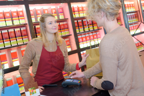 seller and customer in a store tea