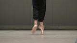 Feet of the ballerina during the ballet  rehearsal. - 209194447
