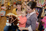 charming family spends time in toy shop - 209194672