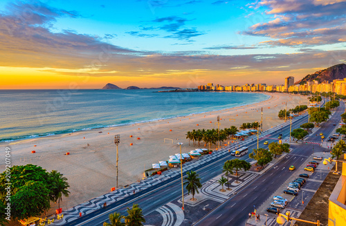 Leinwanddruck Bild Sunrise view of Copacabana beach and Avenida Atlantica in Rio de Janeiro, Brazil