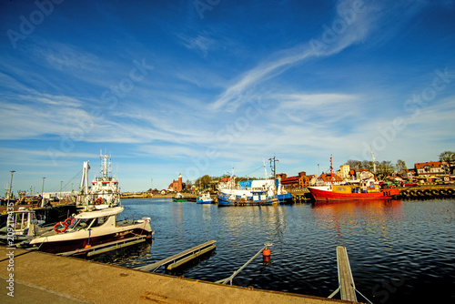 Fotobehang Schip Fishing port of Ustka with old lighthouse