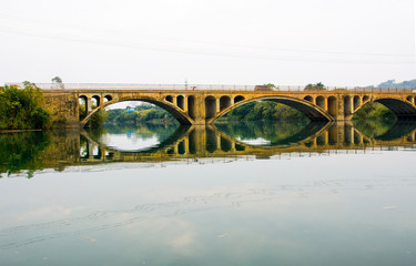 Vintage bridge in China reflected in the lake © creativefamily