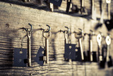 Closeup of old keys for hotel rooms on wooden wall - 209217001