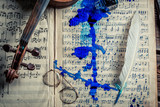 Closeup of old sheets and violin with ink and feather - 209217612