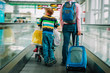 family -mother with kids walk in airport