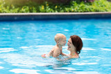 Mother and baby in swimming pool - 209224077