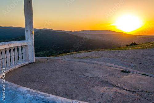 Fotobehang Diepbruine Picturesque sunset